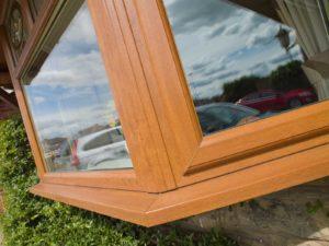 Woodgrain bow bay windows